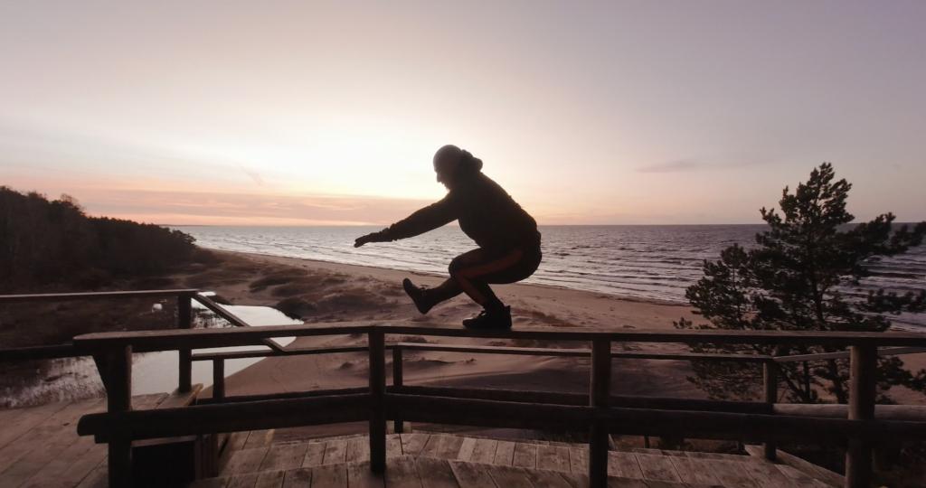 Cambo doing pistol squat at sunset when visiting Latvia