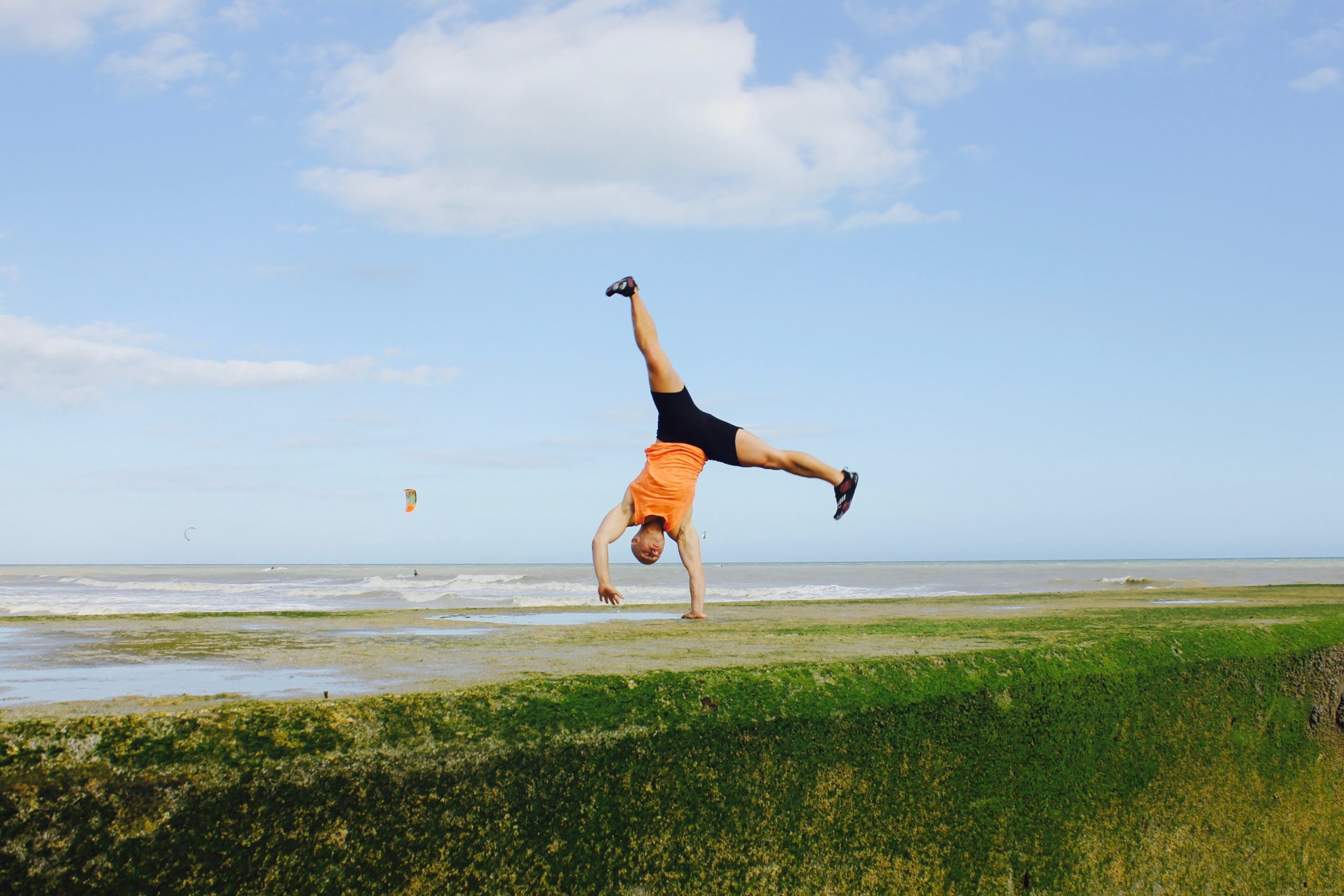 One arm handstand in beach